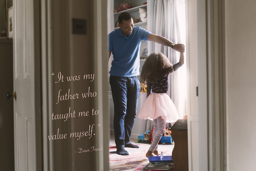 dad and daughter images with quotes: Happy father and girl dancing in bedroom. Cheerful man and daughter are enjoying at home. They are spending leisure time.