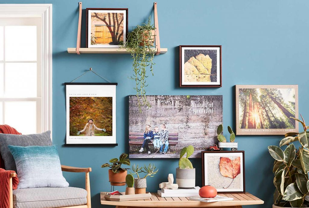 Photo gallery wall on blue wall with home decor