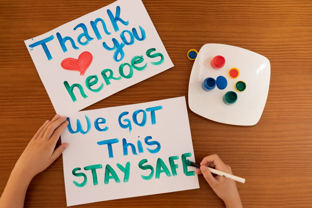Close up hand of child making positive messages to frontline heroes working during Coronavirus (COVID-19) quarantine.